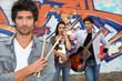Band next to grafitti wall