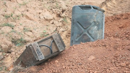 Combat Boots Lugging A Crate Up A Bank