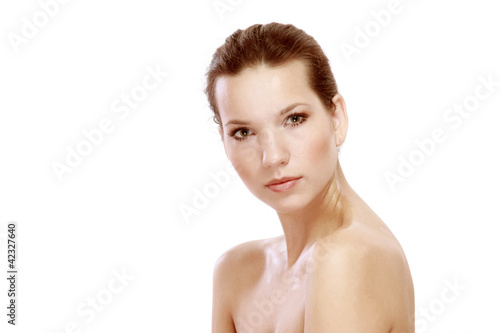 Beautiful young female face isolated on white background