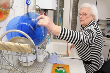 Senior woman puts plate