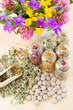 different healing herbs in glass bottles, flowers bouqet in mort