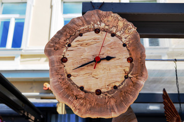 Handmade wooden clock decorated with amber stones