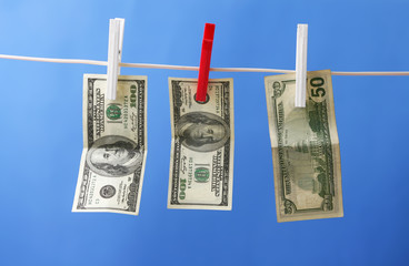 Dollar's Hanging on Rope with Clothespins isolated background