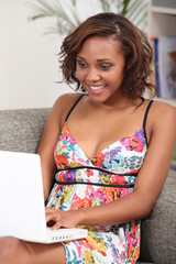 Young brunette with computer