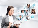Fototapety Portrait of businesswoman holding her tablet computer and commun