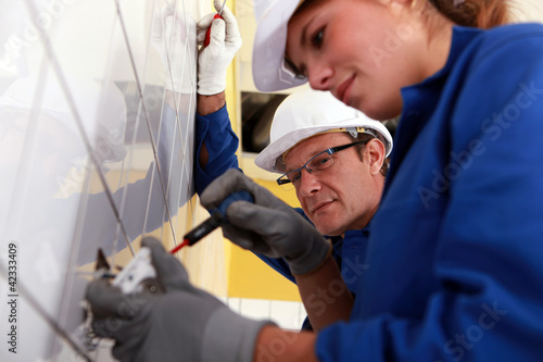 electricians working on a construction site