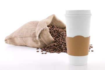 Disposable cup of coffee over sack of coffee beans