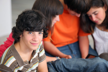 Portrait of teenager with his friends