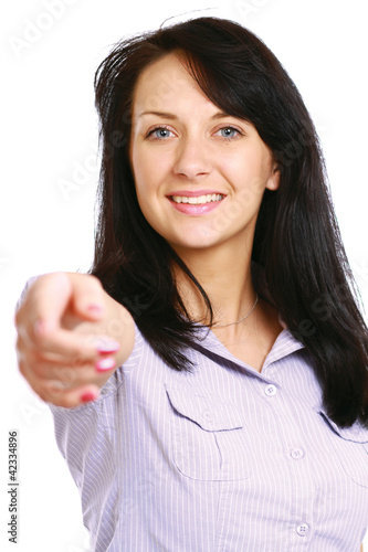 Portrait of a beautiful young woman pointing at you