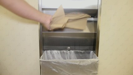Taking Paper Towels From Dispenser Throwing Away