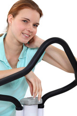 Woman on cycling machine