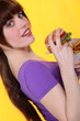 Oblique image of girl with burger