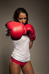 Athletic woman boxer throwing a punch
