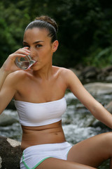 beautiful woman drinking spring water