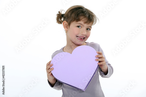 portrait of little girl receiving gift