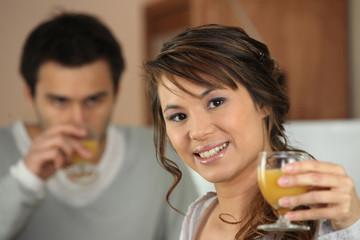 Couple drinking orange juice