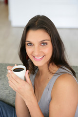 Woman starting the day with a nice cup of coffee