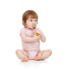 Funny sitting baby  with musical toy. Isolated on white backgrou