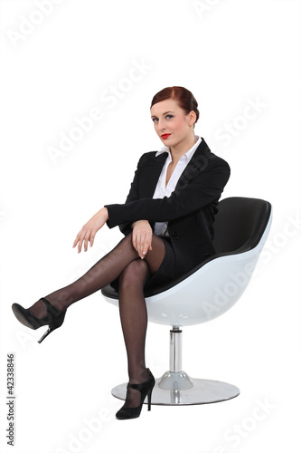 Businesswoman sat in swivel chair