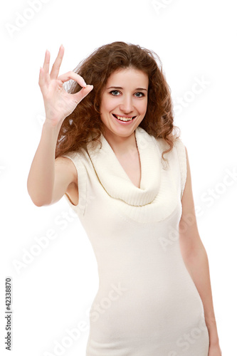 A smiling woman showing okay sign, isolated on white