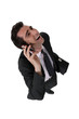 businessman talking on his cell and laughing