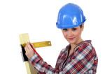 craftswoman taking measurements