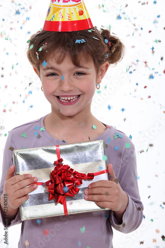Little girl receiving birthday present