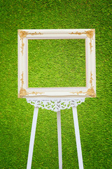 picture frame on green grass