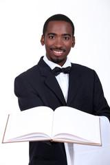black man presenting a book
