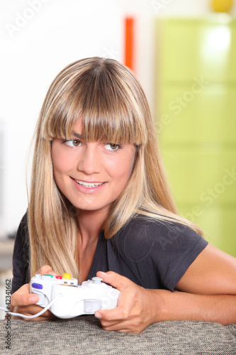 Girl playing on games console