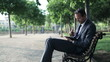 Businessman with tablet computer and documents in the park