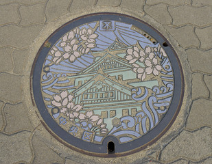 Sewer manhole with Osaka castle picture