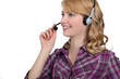 Friendly woman with a telephone headset