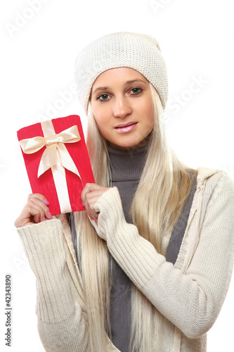 Beautiful surprised woman holding gift with ribbon