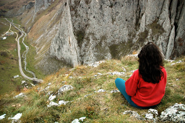 Beautiful limestone gorge and a woman admiring it