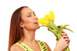 picture of happy woman with yellow tulips over white