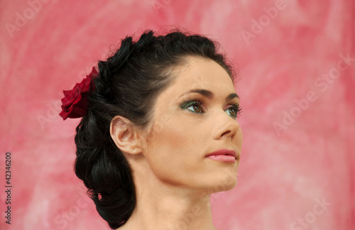 Portrait of brunette woman on a pink background