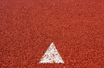 arrow sign on running track rubber cover texture for background