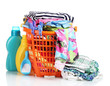 Clothes with detergent and washing powder in orange basket