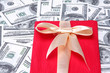 heap of dollars with red gift