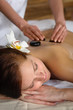Hot stone massage woman enjoy spa treatment