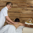 Back brush massage at luxury spa centre