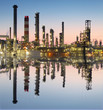 Oil and gas refinery with reflection in water