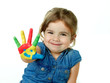 Little girl is proud of her coloured hand
