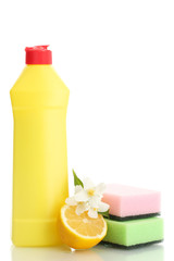 Dishwashing liquid with sponges and lemon with flowers isolated
