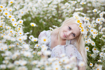 Girl hiding herself beneath flowers
