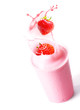 Ripe strawberries splashing into fruit smoothie