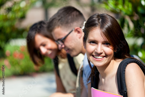 Young happy students after the exams