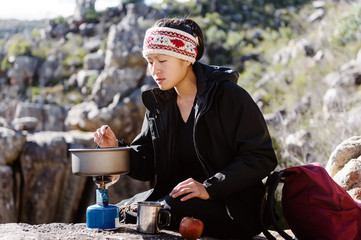 Cooking hiker woman