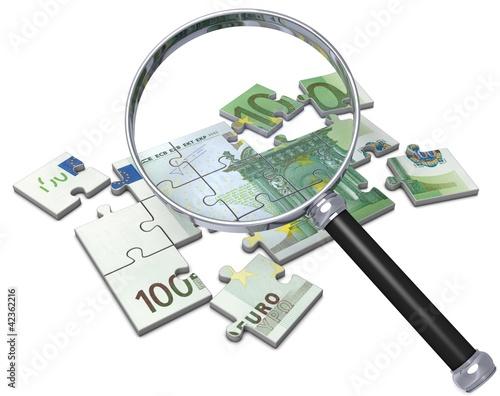 Geld Puzzle mit Lupe